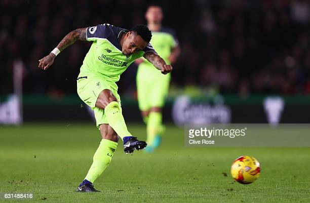 Nathaniel Clyne of Liverpool shoots during the EFL Cup semifinal first leg match between Southampton and Liverpool at St Mary's Stadium on January 11...