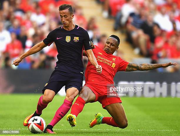 Nathaniel Clyne of Liverpool tackles Juan Camara of Barcelona during the International Champions Cup match between Liverpool and Barcelona at Wembley...