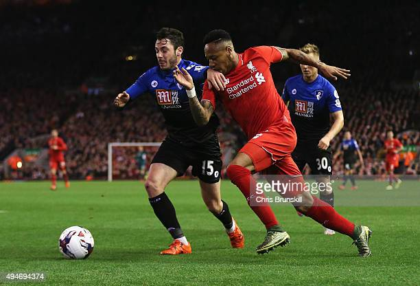 Nathaniel Clyne of Liverpool takes on Adam Smith of Bournemouth during the Capital One Cup Fourth Round match between Liverpool and AFC Bournemouth...