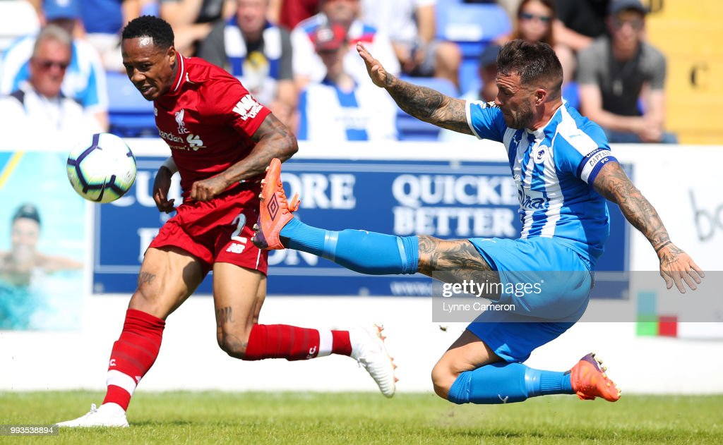Nathaniel Clyne of Liverpool tries to defend during the Pre-season friendly between Chester FC and Liverpool on July 7, 2018 in Chester, United Kingdom.