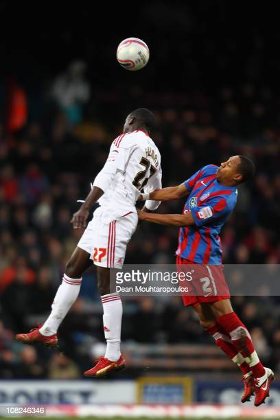 Nathaniel Clyne of Palace is beaten to the header by Albert Adomah of Bristol City during the npower Championship match between Crystal Palace and...