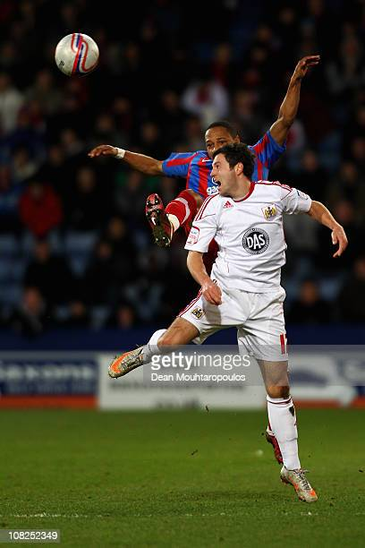Nathaniel Clyne of Palace is beaten to the header by Ivan Sproule of Bristol City during the npower Championship match between Crystal Palace and...