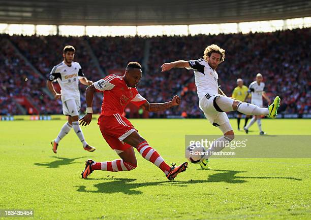 Nathaniel Clyne of Southampton crosses the ball ahead of Jose Alberto Canas of Swansea City during the Barclays Premier League match between...
