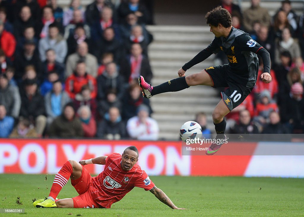 Nathaniel Clyne of Southampton is challenged by Philippe Coutinho of Liverpool during the Barclays Premier League match between Southampton and Liverpool at St Mary's Stadium on March 16, 2013 in Southampton, England.