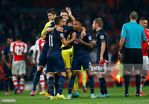 Nathaniel Clyne of Southampton is congratulated at full time after their 21 win during the Capital One Cup Third Round match between Arsenal and...