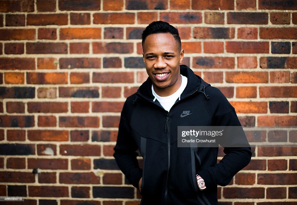 Nathaniel Clyne poses for a photo during the Premier League Players Kit Scheme Launch at Allen Edward Primary School on March 17, 2015 in London, England.