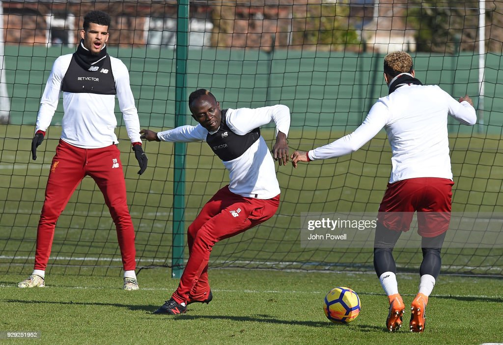 Nathaniel Clyne, Sadio Mane and Dominic Solanke of Liverpool during a training session at Melwood Training Ground on March 8, 2018 in Liverpool, England.
