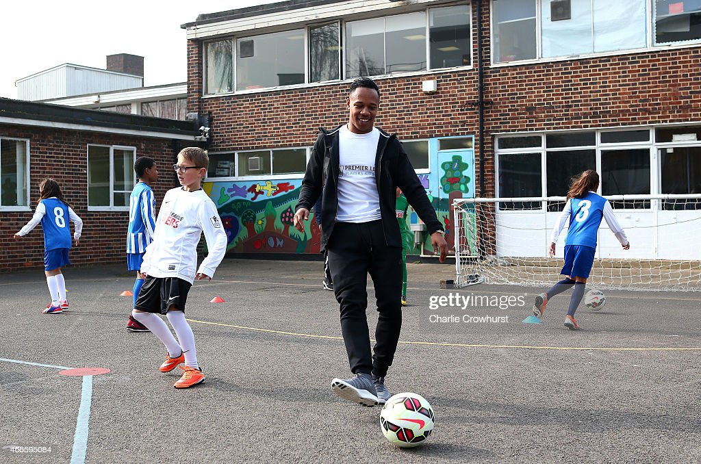 Nathaniel Clyne takes part in activities with the school children during the Premier League Players Kit Scheme Launch at Allen Edward Primary School on March 17, 2015 in London, England.