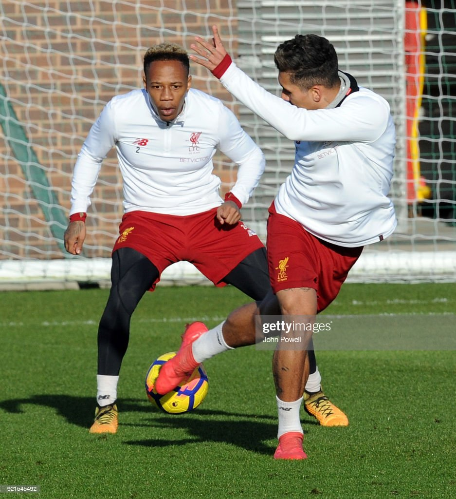 Nathaniel Clyne with Roberto Firmino of Liverpool during a training session at Melwood Training Ground on February 20, 2018 in Liverpool, England.