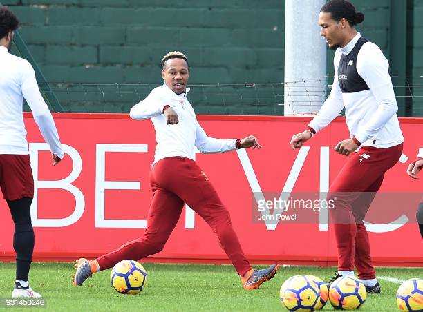 MARCH 13 Nathaniel Clyne with Virgil van Dijk of Liverpool during a training session at Melwood Training Ground on March 13 2018 in Liverpool England