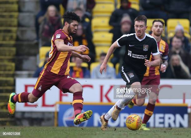 Nathaniel KnightPercival of Bradford Citymoves forward with the ball watched by Chris Long of Northampton Town during the Sky Bet League One match...