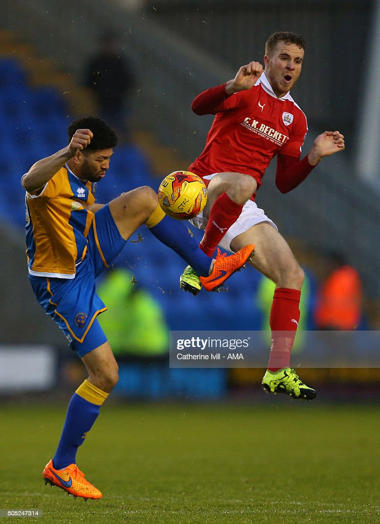 Nathaniel Knight-Percival of Shrewsbury Town and Marley Watkins of Barnsley during the Sky Bet League One match between Shrewsbury Town and Barnsley at New Meadow on January 16, 2016 in Shrewsbury, England.