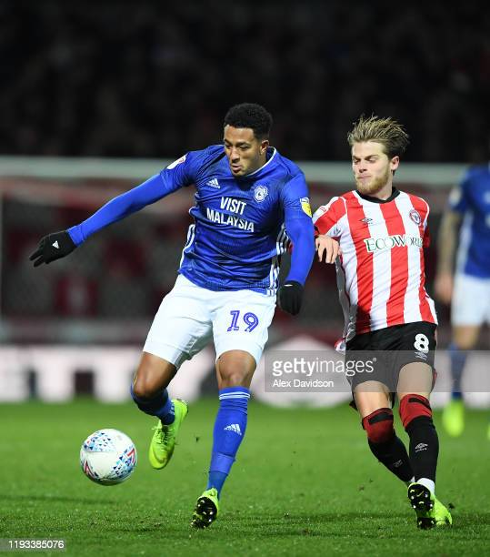 Nathaniel MendezLaing of Cardiff City battles for possession with Mathias Jensen of Brentford during the Sky Bet Championship match between Brentford...