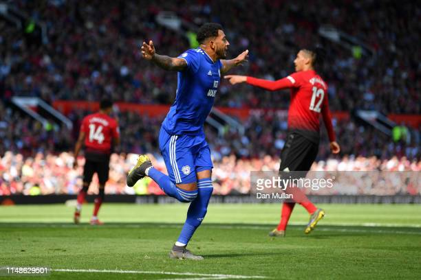Nathaniel Mendez-Laing of Cardiff City celebrates after scoring his team's first goal during the Premier League match between Manchester United and...