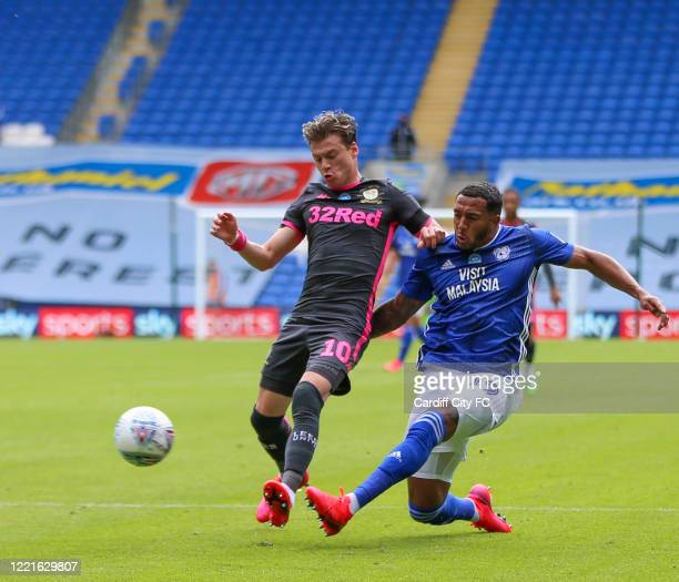 Nathaniel MendezLaing of Cardiff City FC and Ezgjan Alioski of Leeds United during the Sky Bet Championship match between Cardiff City and Leeds...