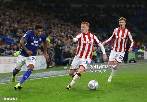 Nathaniel MendezLaing of Cardiff City FC and Ryan Woods of Stoke City during the Sky Bet Championship match between Cardiff City and Stoke City at...
