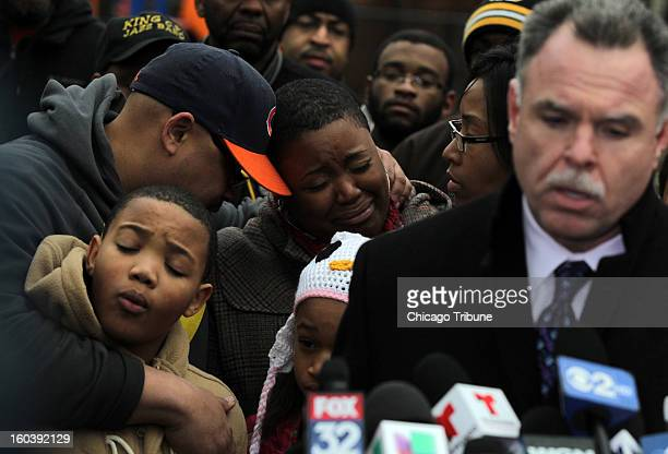 Nathaniel Pendleton Jr from left father Nathaniel Pendleton and mother Cleopatra CowleyPendleton weep as Chicago Police Superintendent Garry McCarthy...