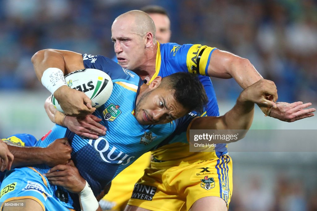 Nathaniel Peteru of the Titans is tackled during the round three NRL match between the Gold Coast Titans and the Parramatta Eels at Cbus Super Stadium on March 17, 2017 in Gold Coast, Australia.