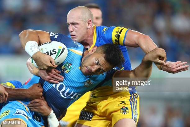 Nathaniel Peteru of the Titans is tackled during the round three NRL match between the Gold Coast Titans and the Parramatta Eels at Cbus Super...