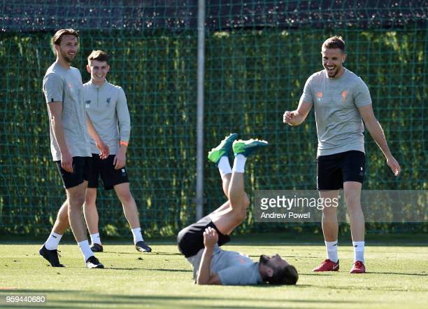 Nathaniel Phillips Ben Woodburn and Jordan Henderson of Liverpool laughing at Adam Lallana during a training session at Marbella Football Center on...