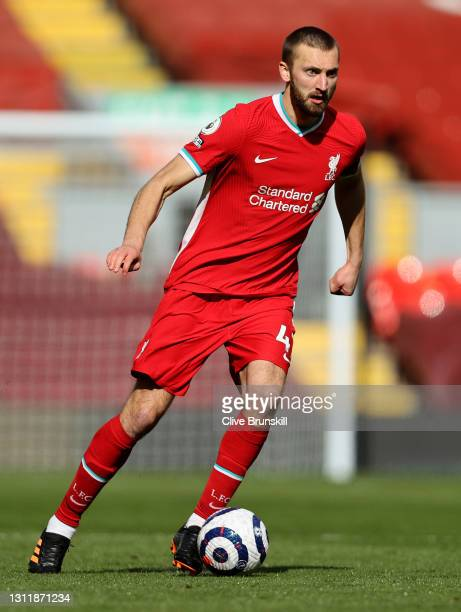 Nathaniel Phillips of Liverpool runs with the ball during the Premier League match between Liverpool and Aston Villa at Anfield on April 10, 2021 in...