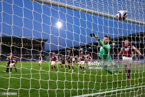 Nathaniel Phillips of Liverpool scores their side's second goal past Will Norris of Burnley during the Premier League match between Burnley and...