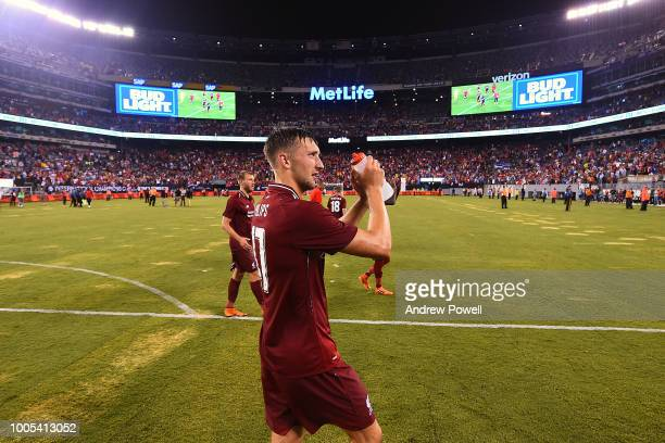 Nathaniel Phillips of Liverpool shows his appreciation to the fans at the end of the International Champions Cup 2018 match between Manchester City...