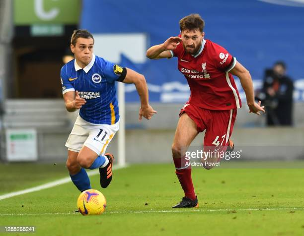 Nathaniel Phillips of Liverpool with Brighton & Hove Albion's Leandro Trossard during the Premier League match between Brighton & Hove Albion and...