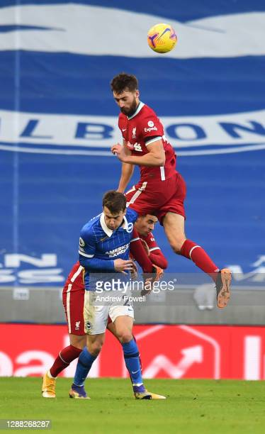 Nathaniel Phillips of Liverpool with Brighton & Hove Albion's Solly March during the Premier League match between Brighton & Hove Albion and...