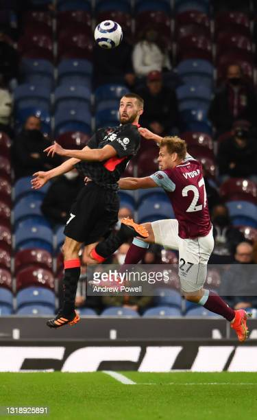 Nathaniel Phillips of Liverpool with Burnley's Matej Vydra during the Premier League match between Burnley and Liverpool at Turf Moor on May 19, 2021...