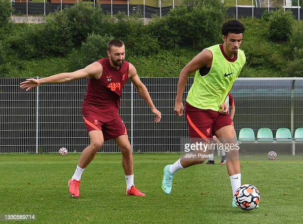 Nathaniel Phillips of Liverpool with Curtis Jones of Liverpool during a training session on July 25, 2021 in UNSPECIFIED, Austria.