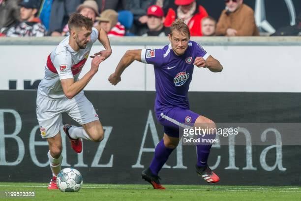 Nathaniel Phillips of VfB Stuttgart and Jan Hochscheidt of Erzgebirge Aue battle for the ball during the Second Bundesliga match between VfB...