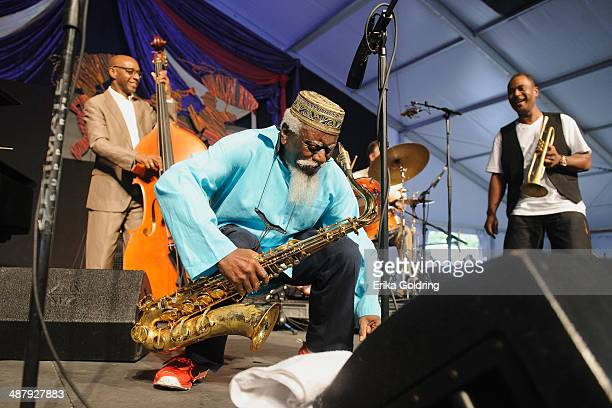 Nathaniel Reeves, Pharoah Sanders and Marlon Jordan perform during the 2014 New Orleans Jazz & Heritage Festival at Fair Grounds Race Course on May...