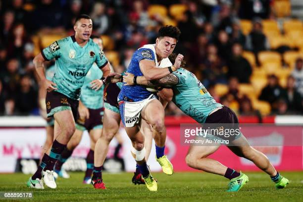 Nathaniel Roache of the Warriors is tackled by Korbin Sims of the Broncos during the round 12 NRL match between the New Zealand Warriors and the...