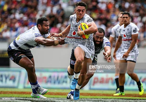 Nathaniel Roache of the Warriors makes a break during the 2016 Auckland Nines match between the Warriors and the Cowboys at Eden Park on February 6...