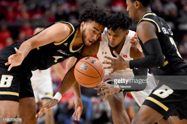 Nathaniel Stokes of the Bryant University Bulldogs and Donta Scott of the Maryland Terrapins go after the ball during the second half at Xfinity...