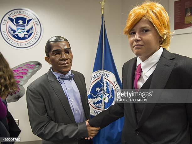Nathnael Asegdew from Ethiopia dressed as US President Barack Obama and Razvan Godja from Romania dressed as Donald Trump shake hands as 27 children...