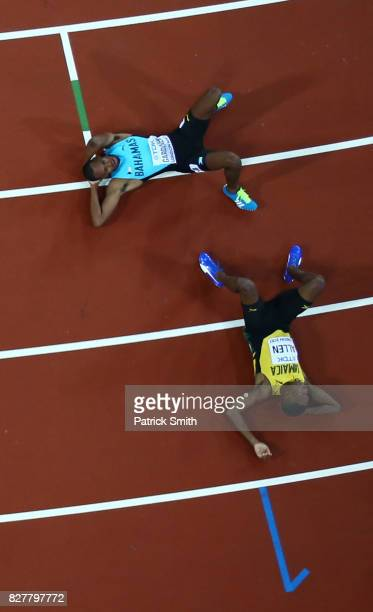 Nathon Allen of Jamaica Steven Gardiner of the Bahamas and Fred Kerley of the United States react after the Men's 400 metres final during day five of...