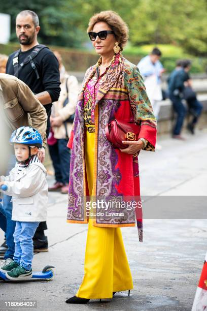 Nati Abascal wearing a printed coat yellow pants and Etro bag is seen outside the Valentino show during Paris Fashion Week Womenswear Spring Summer...
