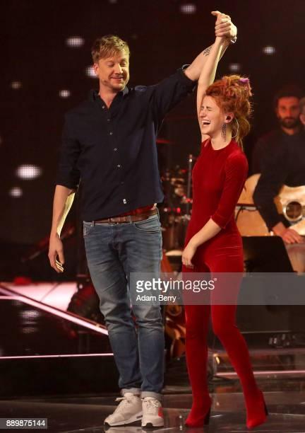 Natia Todua is congratulated by Samu after winning the 'The Voice of Germany' semifinals at Studio Berlin Adlershof on December 10 2017 in Berlin...