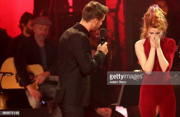 Natia Todua reacts after winning the 'The Voice of Germany' semifinals at Studio Berlin Adlershof on December 10 2017 in Berlin Germany The finals...