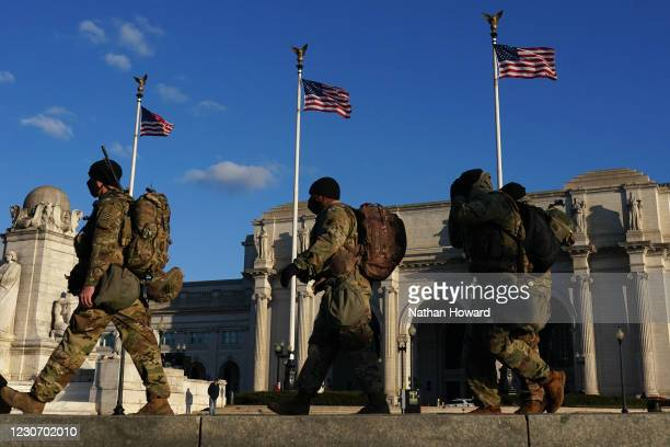 Natiaonl Guard troops cross the street near Union Station on January 20, 2021 in Washington, DC. Law enforcement and state officials are on high...