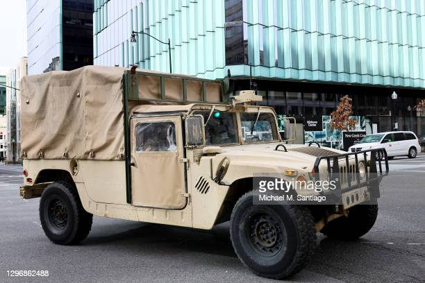Nation Guardsmen in a Humvee drive through the intersection of 15th street NW and L street NW on January 17, 2021 in Washington, DC. After last...