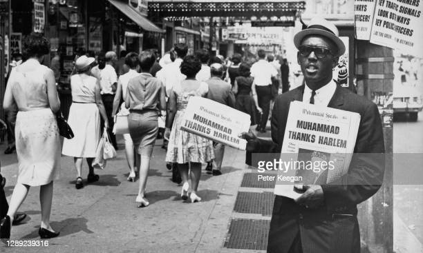 Nation of Islam activist distributing copies of the African-American organisation's newspaper 'Muhammad Speaks' with the headline 'Muhammad thanks...