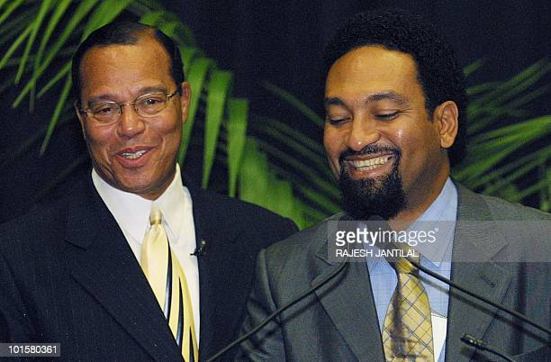 Nation of Islam leader Louis Farrakhan and the son of Kwame Nkrumah of Ghana, Gamal Nkrumah share a light moment during a press briefing at the...