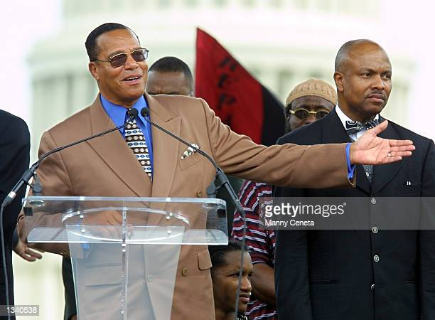 Nation of Islam leader Louis Farrakhan gestures as he addresses demonstrators on the issue of slave reparations on the National Mall August 17, 2002...