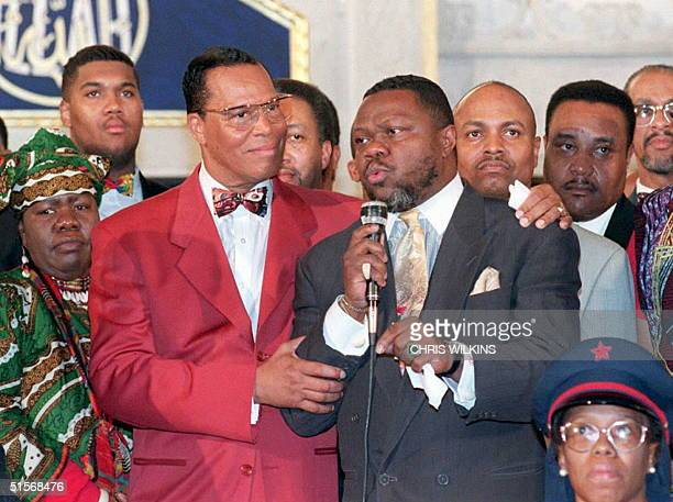 Nation of Islam leader Louis Farrakhan puts his arm around Christian cleryman Al Sampson as he speaks in support of Farrakhan 17 Jaunary in Chicago...