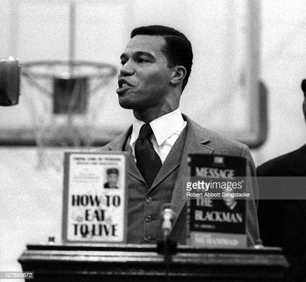 Nation of Islam leader Louis Farrakhan speaks from behind a lecturn at Tennessee State University Nashville Tennessee 1969 On the lecturn are a pair...