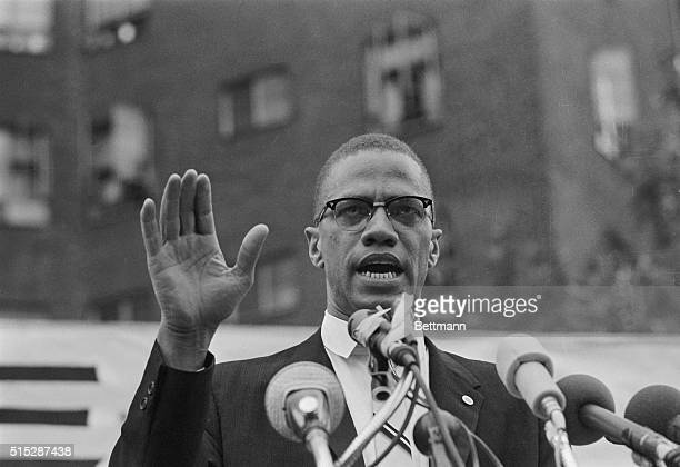 Nation of Islam leader Malcolm X draws various reactions from the audience as he restates his theme of complete separation of whites and African...