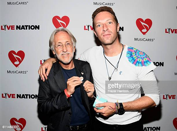 National Academy of Recording Arts and Sciences President Neil Portnow and Singer Chris Martin attend a special performance by Coldplay's Chris...